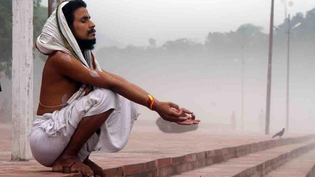 En prière, Inde, Oasis